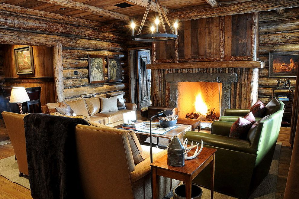 Distressed Leather Club Chair   Rustic Family Room  and Antlers Decorative Pillows Family Room Fireplace Green Leather Club Chair Leather Couch Lodge Log Cabin Round Chandelier Rustic Throw Pillows Wood Fireplace Surround Wood Flooring Wood Paneling