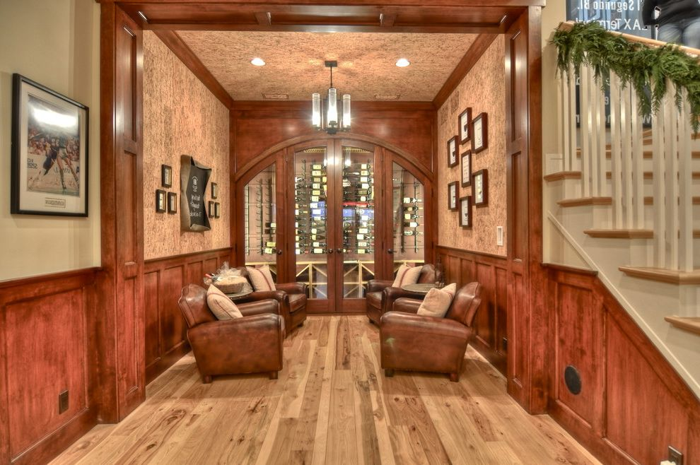 Distressed Leather Club Chair   Traditional Wine Cellar  and Arch Entry Foyer Glass Doors Glass Tube Chandelier Holiday Greens Leather Club Chairs Staircase Wood Floor Wood Wainscoting