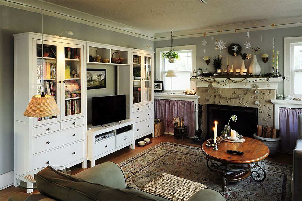 Distressed Wood Entertainment Center with Eclectic Living Room  and Area Rug Christmas Decorations Crown Molding Fireplace Mantel Fireplace Surround Holiday Decorations Media Storage Oriental Rug Seasonal Decorations Wood Coffee Table Wood Flooring