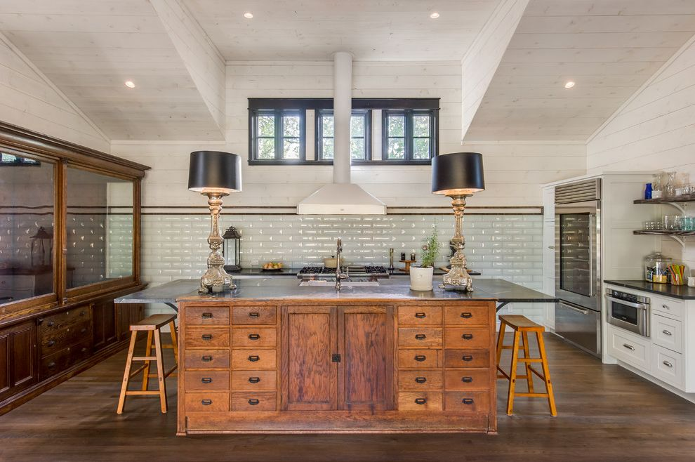 Dixie Pools   Farmhouse Kitchen Also Contemporary Farm House Gourmet Island with Storage Remodel Renovation Row of Windows Tall Ceilings Wood Counter Stools