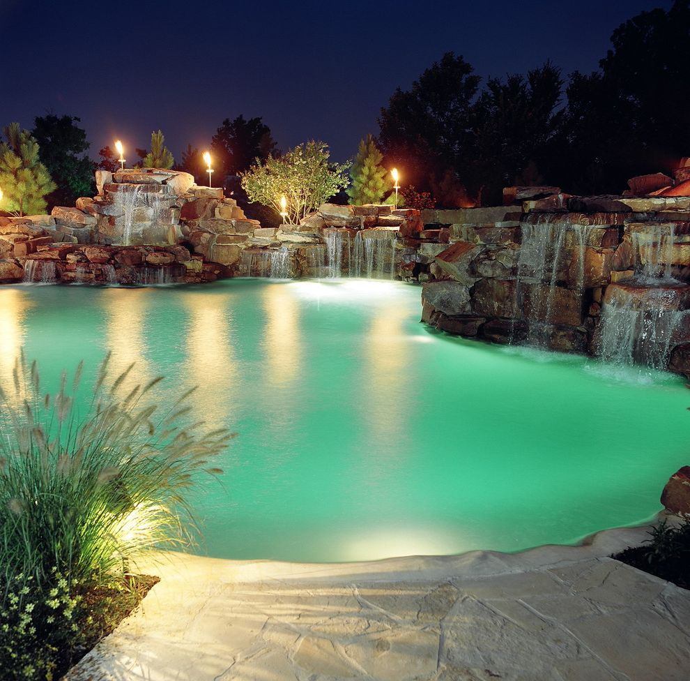 Dixie Pools with Tropical Pool  and Accent Lighting Boulder Landscape Night Lighting Pool Pool Water Feature Pool Water Fountain Pool Waterfall Rock Landscape Stone Patio Tall Grass Tiki Torch