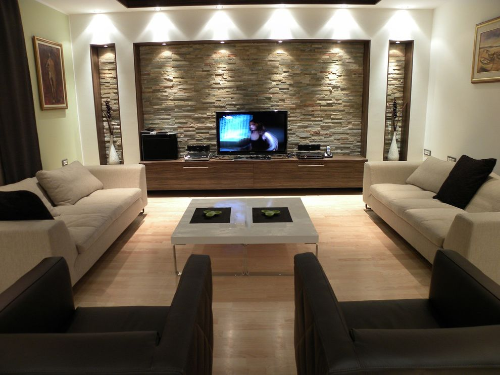 Diy Network Tv Shows with Contemporary Living Room Also Built in Shelves Ceiling Lighting Coffee Table Display Shelves Neutral Colors Recessed Lighting Stacked Stone Stone Wall Tv Stand Wall Art Wall Decor Wood Flooring