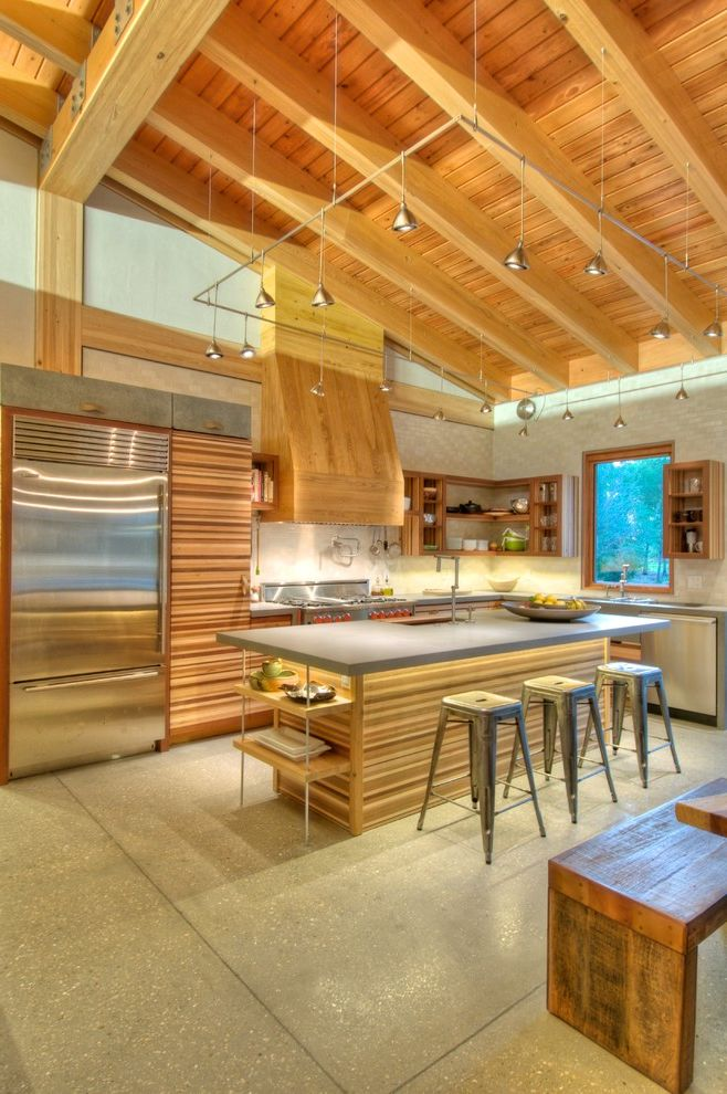 Doctors Review Service   Modern Kitchen  and Butcher Block Concrete Counters Concrete Floor Leather Strap Handles Open Shelving Red Stainless Steel Tile Backsplash Vaulted Ceiling Wood Beams Wood Benches Wood Ceiling Wood Grain Wood Trim
