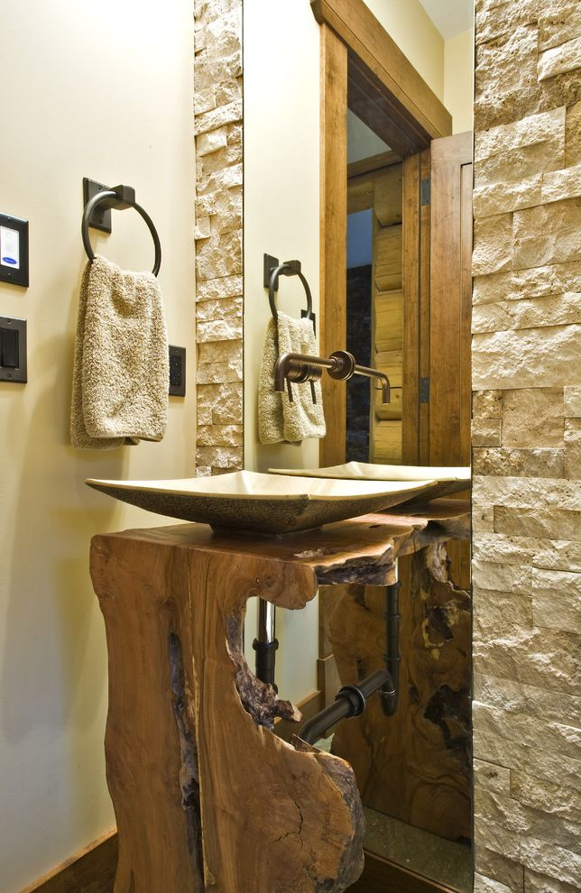 Doctors Review Service with Rustic Bathroom  and Live Edge Wood Countertops Mirror Mount Faucet Neutral Colors Rustic Square Sink Stone Wall Textured Wall Towel Bar Vessel Sink Wall Mount Faucet