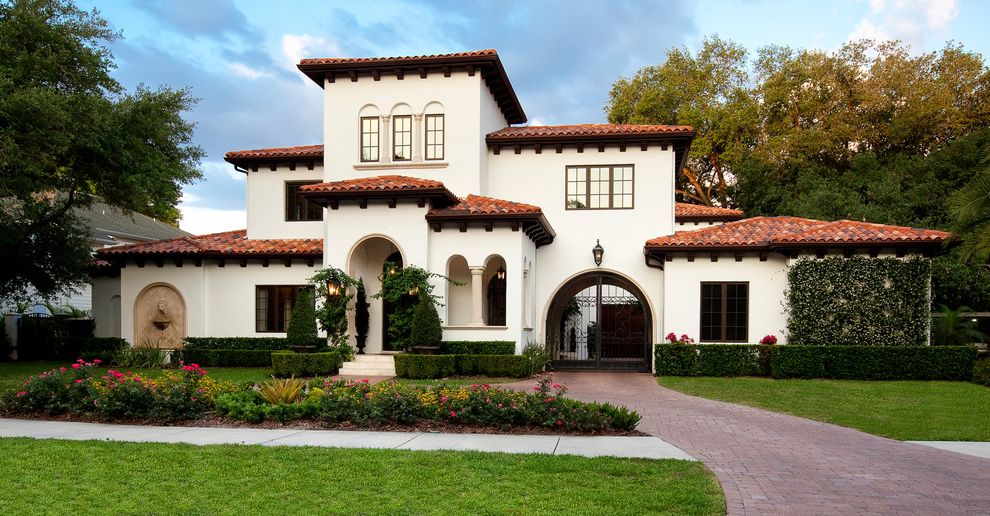 Domain Homes Tampa   Mediterranean Exterior  and Arched Gate Arched Openings Clay Tile Roof Hedges Landscape Spanish Roof Spanish Tile