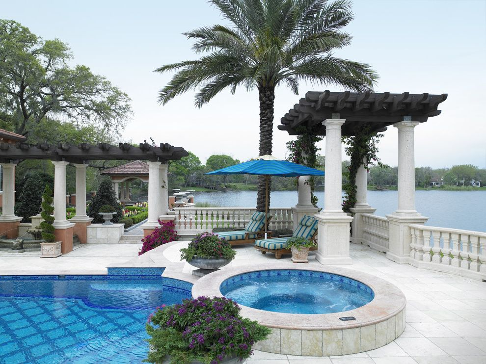 Domain Homes Tampa with Mediterranean Pool  and Arbor Balustrade Chaise Lounge Columns Custom Home Builders Tampa Hot Tub Lake Front Palm Trees Patio Furniture Pool Tile Spa