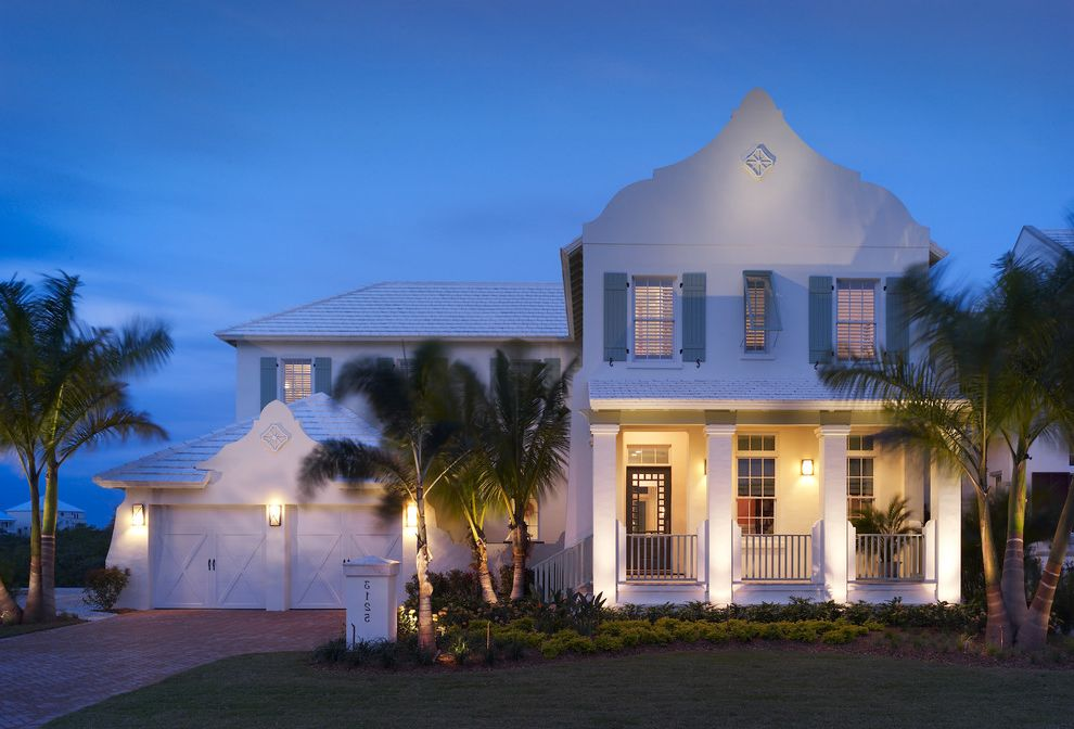 Domain Homes Tampa with Tropical Exterior  and Curb Appeal Driveway Front Yard Garage Doors House Numbers Palm Trees Porch Roofline Window Shutters