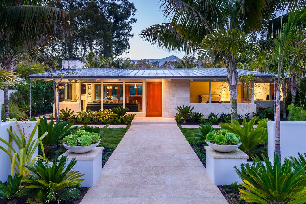Done Rite Roofing with Midcentury Exterior  and Entry Front Entry Gable Roof Landscaping Large Overhang Low Pitch Roof Low Round Planters Metal Roof Mid Century Modern Overhang Palm Trees Planters Standing Seam Metal Roof Stone Vegetation Walkway