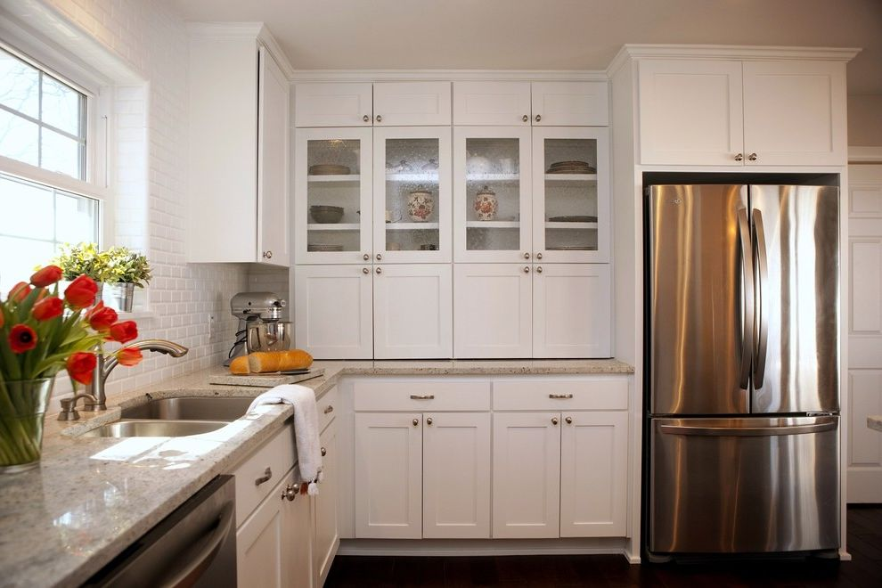 Dons Appliances   Modern Kitchen Also Dark Floor Double Kitchen Sink Flower Vase Glass Cabinets Kitchenaid Mixer Light Granite Countertop Stainless Steel Subway Tile White Cabinets White Kitchen White Tile Backsplash Window Ledge