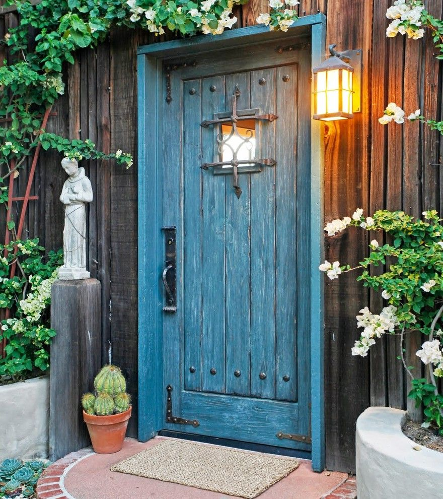Door Mat Inserts   Rustic Entry  and Black Hardware Blue Door Brick Border Cactus Concrete Wall Filagree Painted Door Red Trellis Rustic Rustic Wood Siding Saint Spanish Statue Terracotta Pot Wall Mount Lantern Welcome Mat Woven Mat Wrought Iron