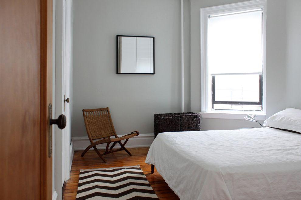 Dorian Gray Painting   Modern Bedroom  and Basket Bedding Chair Chevron Rug Rug Vintage Furniture White and Black Rug White Bedding White Bedroom Wicker Chair Wood Floor