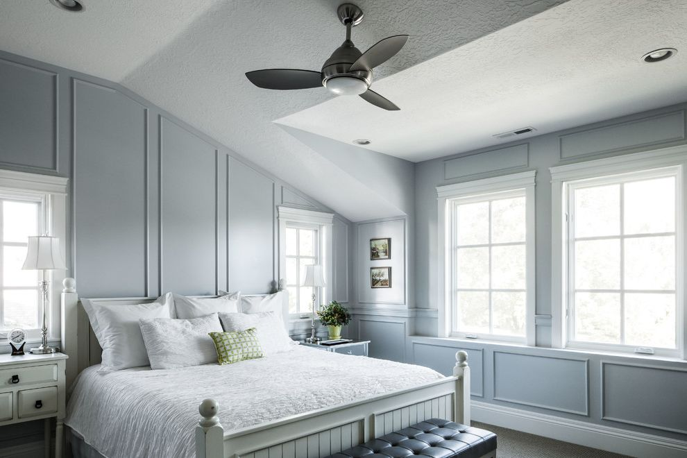 Double Headed Ceiling Fan with Traditional Bedroom Also Bowed Lampshade Gray Wainscoting Gray Wall King Bed Nightstands Three Blade Ceiling Fan Vaulted Ceiling White Bed White Bedding White Headboard