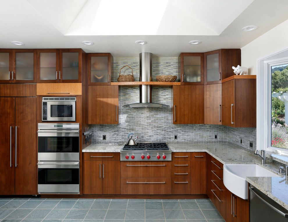 Double Oven with Stove Top with Contemporary Kitchen and Bar Pulls Blue Tile Floor Clerestory Cabinets Hood Skylight