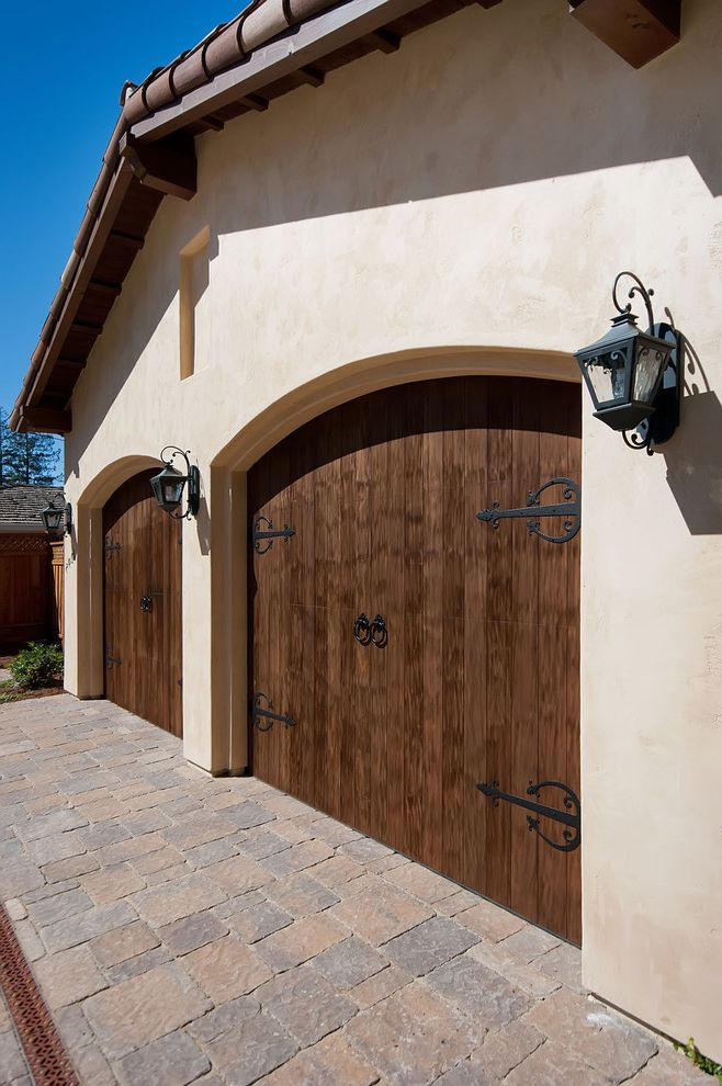Double Wide Garage Door   Mediterranean Garage Also Arched Doorways Barn Hinges Carriage Doors Double Garage Driveway Garage Lanterns Pavers Stucco Tile Roof