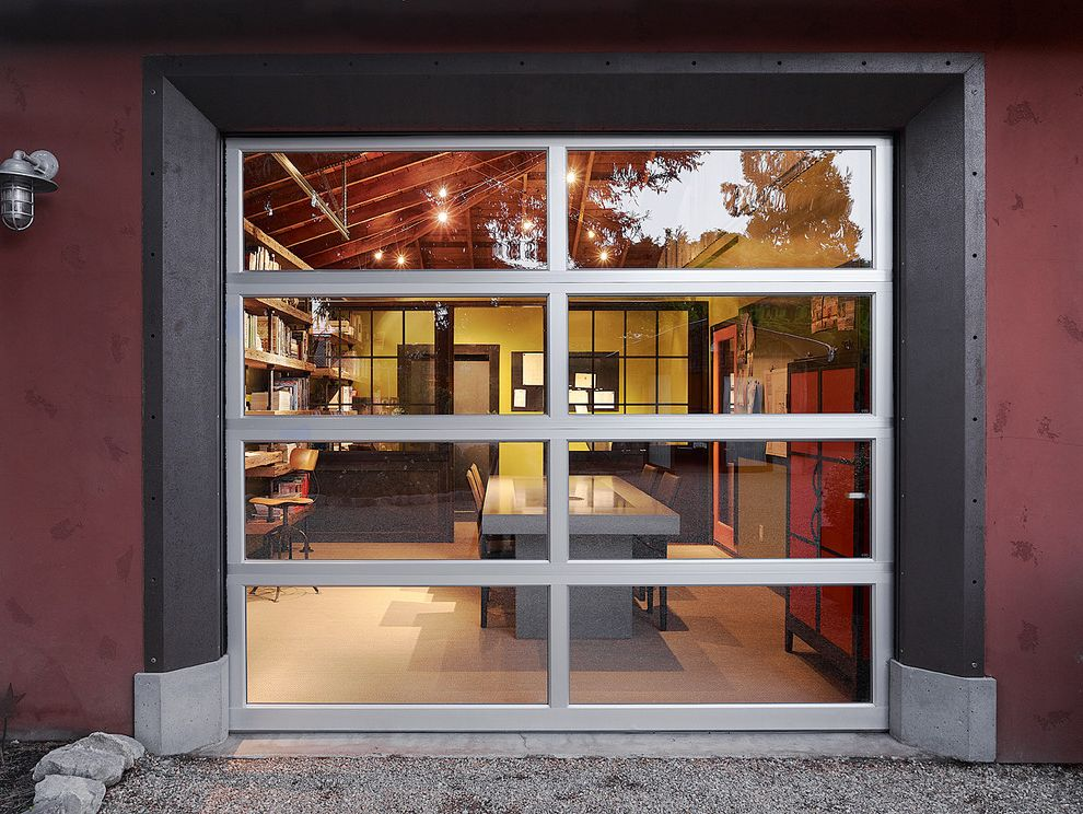 Double Wide Garage Door with Contemporary Home Office  and Concrete Table Conference Room Conference Table Exposed Wood Ceiling Garage Door Gravel Industrial Lantern Poor House Poorhouse Red Walls Sectional Door Studio Workspace
