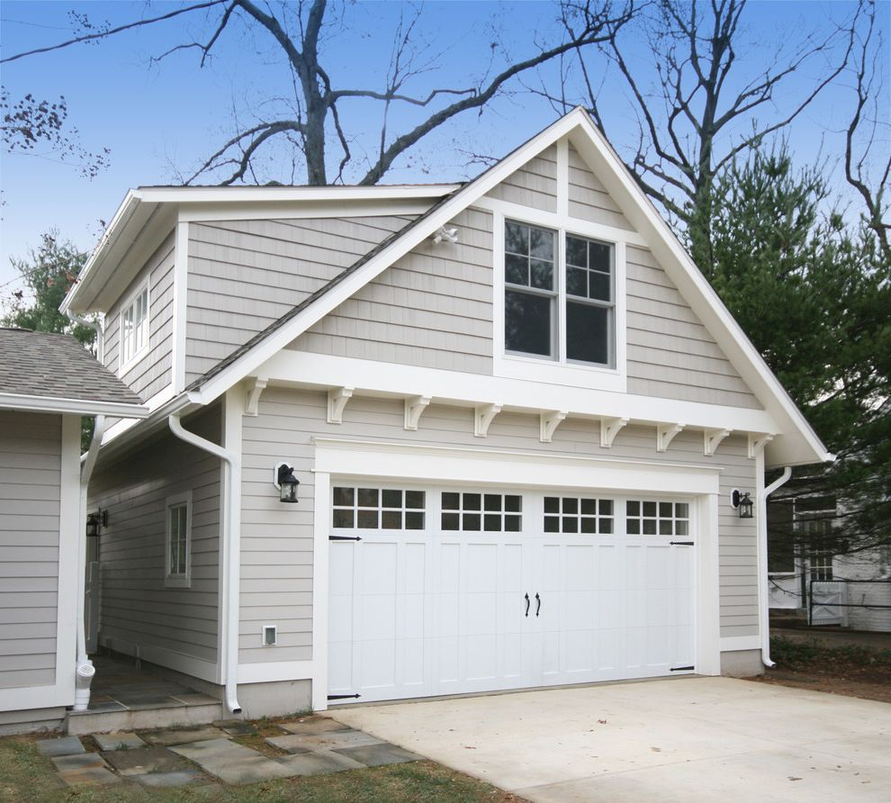 Double Wide Garage Door with Craftsman Garage Also Concrete Driveway Detached Garage Gray Exterior Gray Siding Painted Brick Stone Column Base Stone Pavers Two Car Garage White Garage Door Wood Brackets