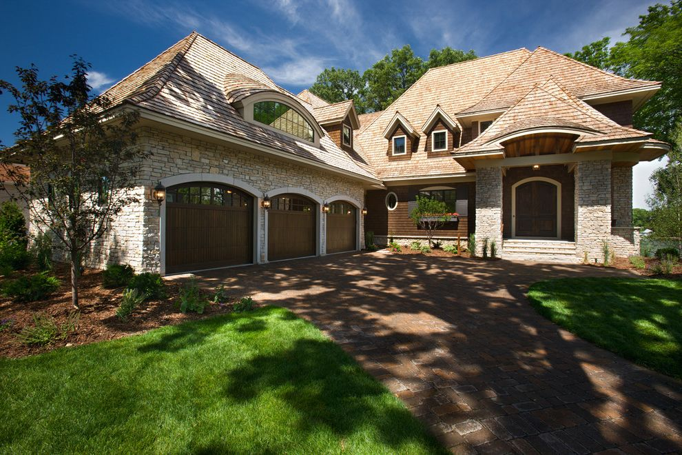 Double Wide Garage Door with Traditional Exterior  and Dormer Double Doors Driveway Entry Eyebrow Dormer Front Porch Garage Door Window Lanterns Portico Shingles Stacked Stone Wood Garage Door