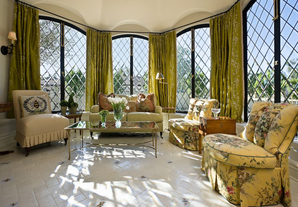 Drapery Rods for Wide Windows with Traditional Living Room Also Bay Window Casement Windows Coffee Table Curtains Drapes Floral Arrangement Floral Chair Floral Pillows Leaded Windows Sconce Slipper Chair Tile Flooring Wall Lighting Window Treatments