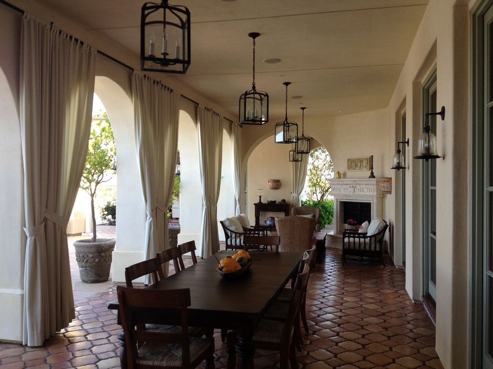 Drapes Definition with Mediterranean Patio Also Chandeliers Glass Sconce Honeycomb Floor Long Dining Table Outdoor Drapes Outdoor Fireplace Patio Cover Pendant Lighting Stucco Wall Terra Cotta Veranda
