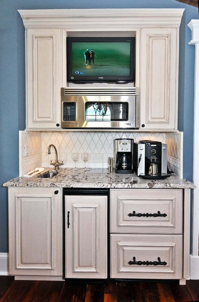 Drink Dispenser with Ice Core with Mediterranean Kitchen Also Baseboards Butler Pantry Dark Floor Distressed Finish Granite Countertops Kitchen Hardware Rustic Tile Backsplash White Cabinets Wood Cabinets Wood Flooring