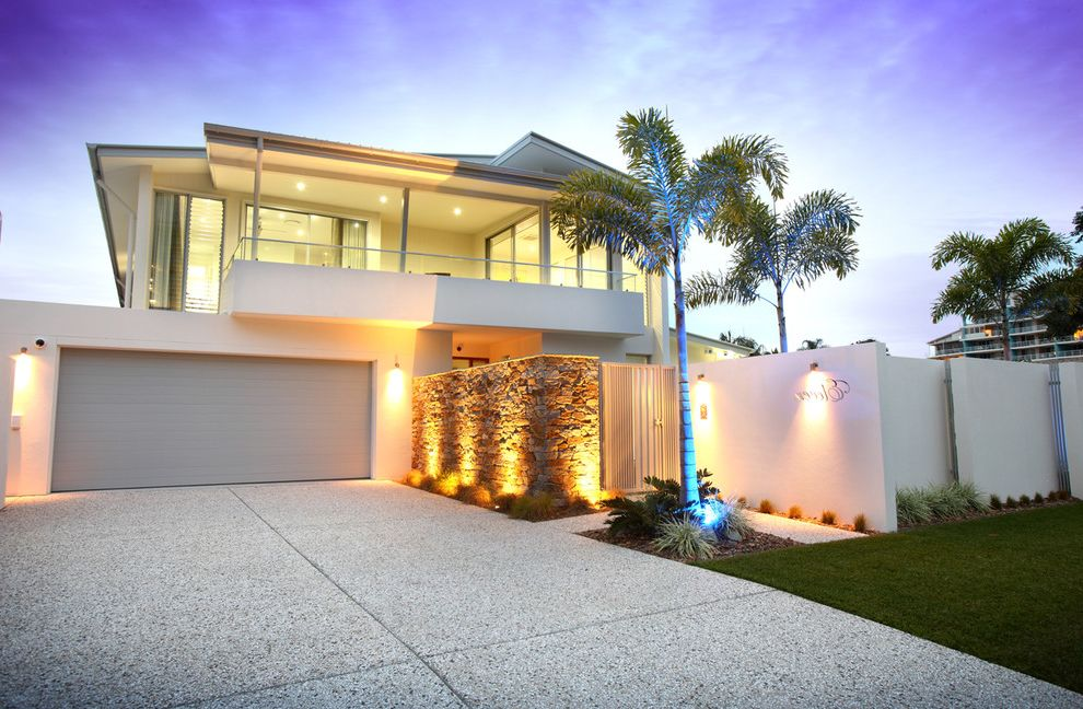 Driveways by Us with Contemporary Exterior Also Accent Lighting Deck Entrance Gate Gray Garage Door Grey Garage Door Outdoor Lighting Palm Tree Patio Stone Wall White Exterior White Siding