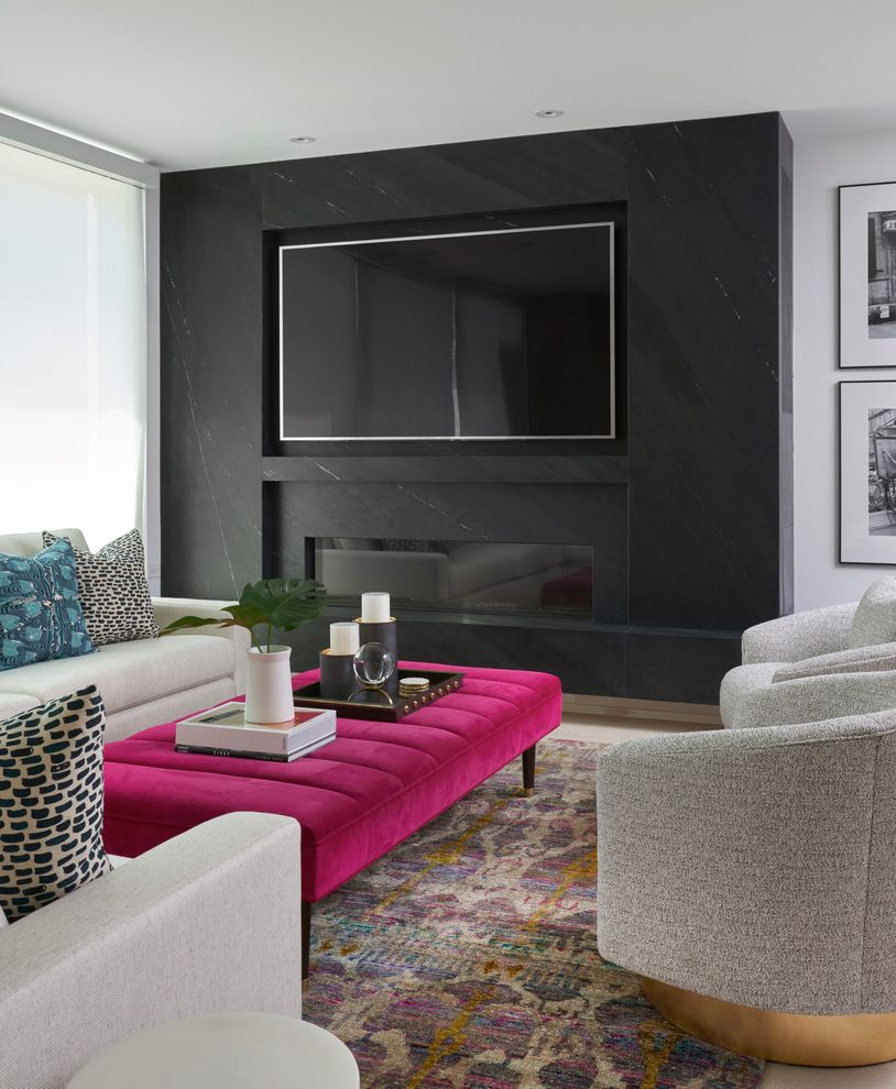 Drop Down Tv Wall Mount with Transitional Living Room  and Black Marble Accent Wall Colorful Rug Gray Armchair Pink Ottoman