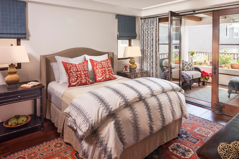 Duvet Definition with Mediterranean Bedroom  and Bamboo Side Tables Blue and White Blue Roman Shades Nailhead Detail Red Accent Pillows