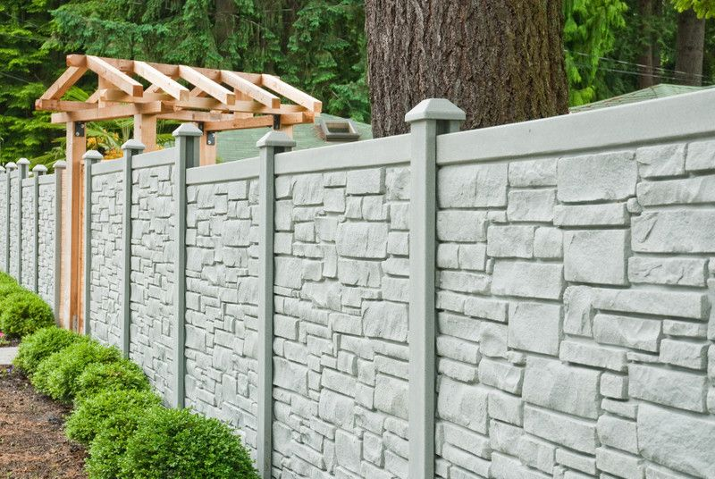 Ecostone Fence with Transitional Landscape Also Cedar Alternative Custom Fencing Front Door Entry Front Entry Privacy Fencing Privacy Screen Rock Wall Simtek Simulated Stone Fencing Stone Fencing Vinyl Alternative