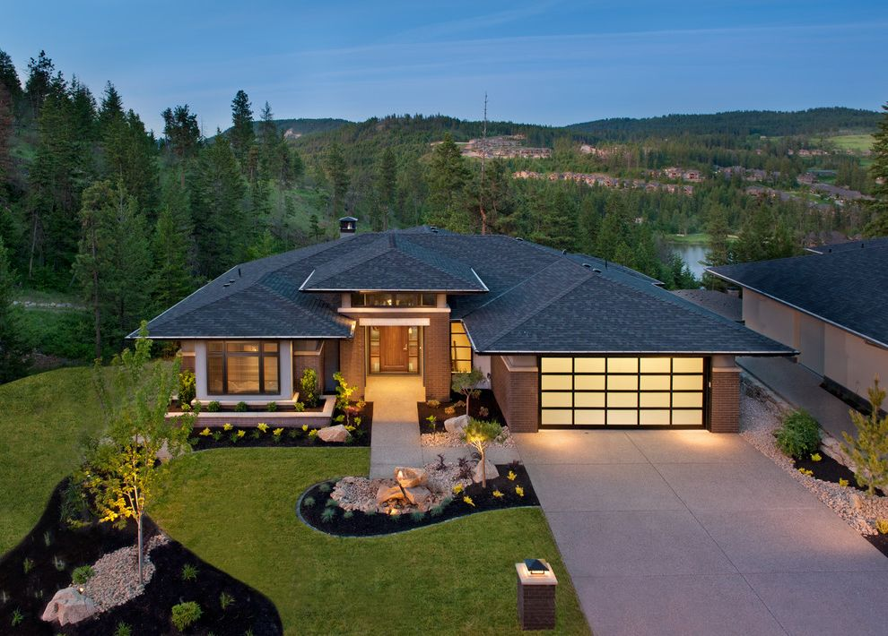 Eden Prairie Theater with Contemporary Exterior  and Brick Covered Entry Curved Garden Driveway Front Door Grass Hardscape Hip Roof Landscape Lawn Natural Landscape Paneled Garage Door Retaining Wall Trees Walkway Windows