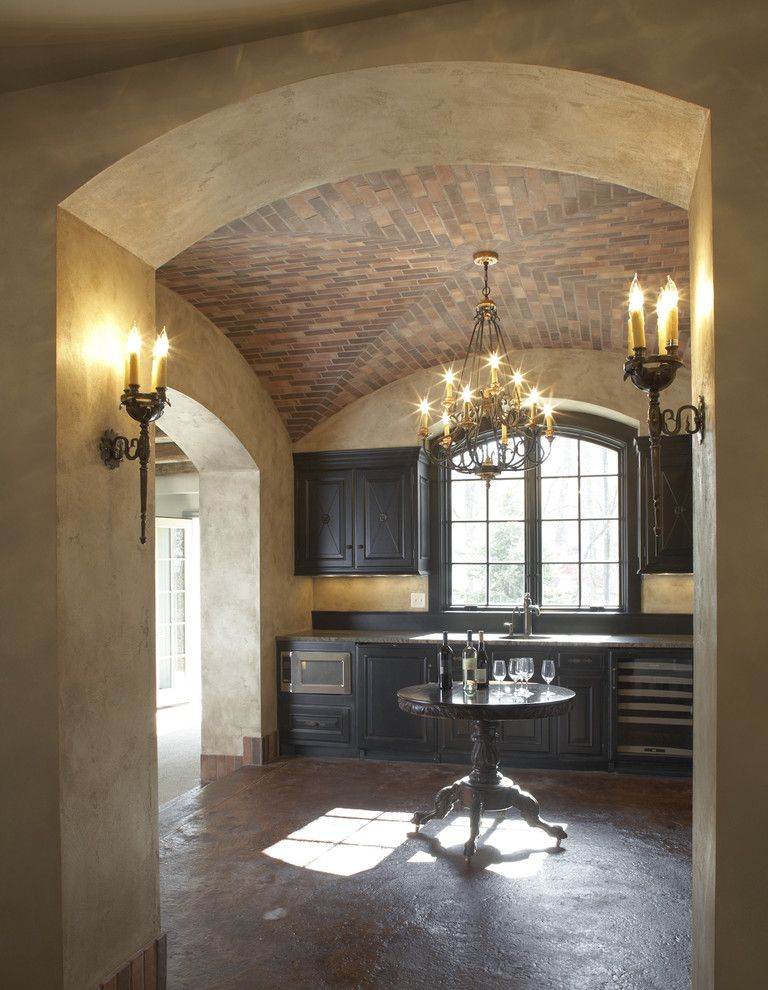 Eden Prairie Theater with Traditional Wine Cellar  and Arched Window Archway Carved Chandelier Dark Tone Wood Round Table Stucco Walls Tile Ceiling Under Cabinet Lighting Wall Sconces Wood Cabinets Wood Table