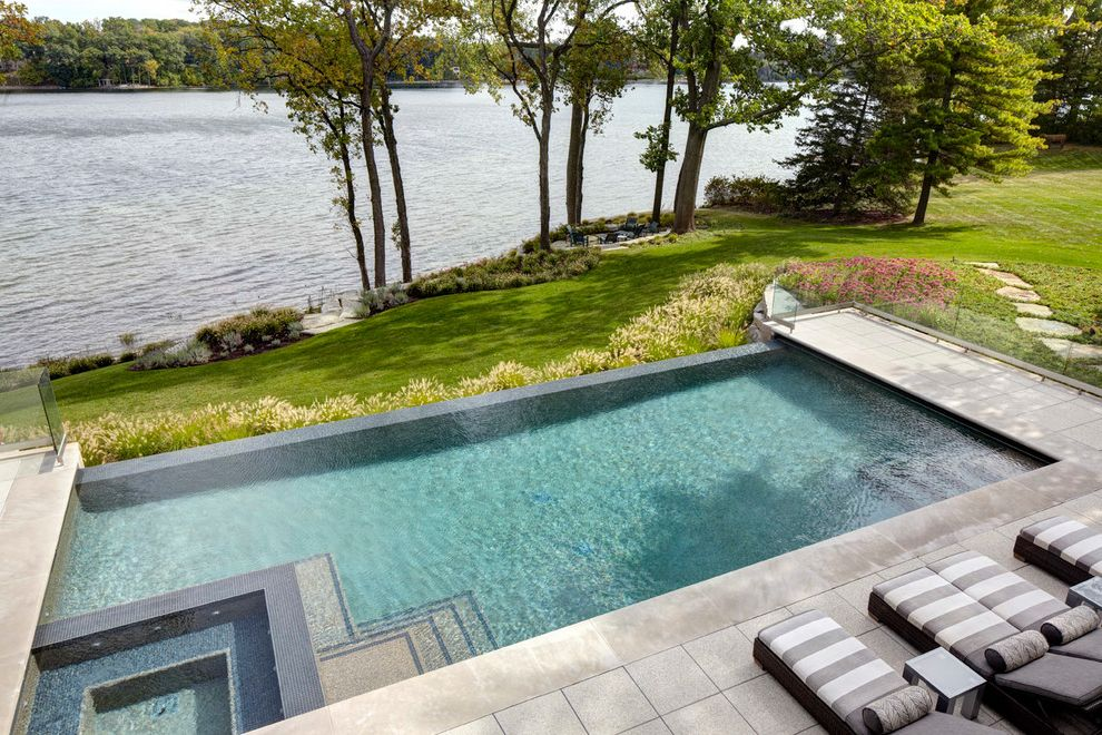 Edge Auto Rental   Modern Pool Also Backyard Flowers Grass Infinity Edge Pool Lakefront Pool Steps Pool Tile Rectangular Pool Rectangular Swimming Pool Spa Bench Spa in Pool Square Spa Striped Cushions Waterfront Landscape Zero Edge Pool