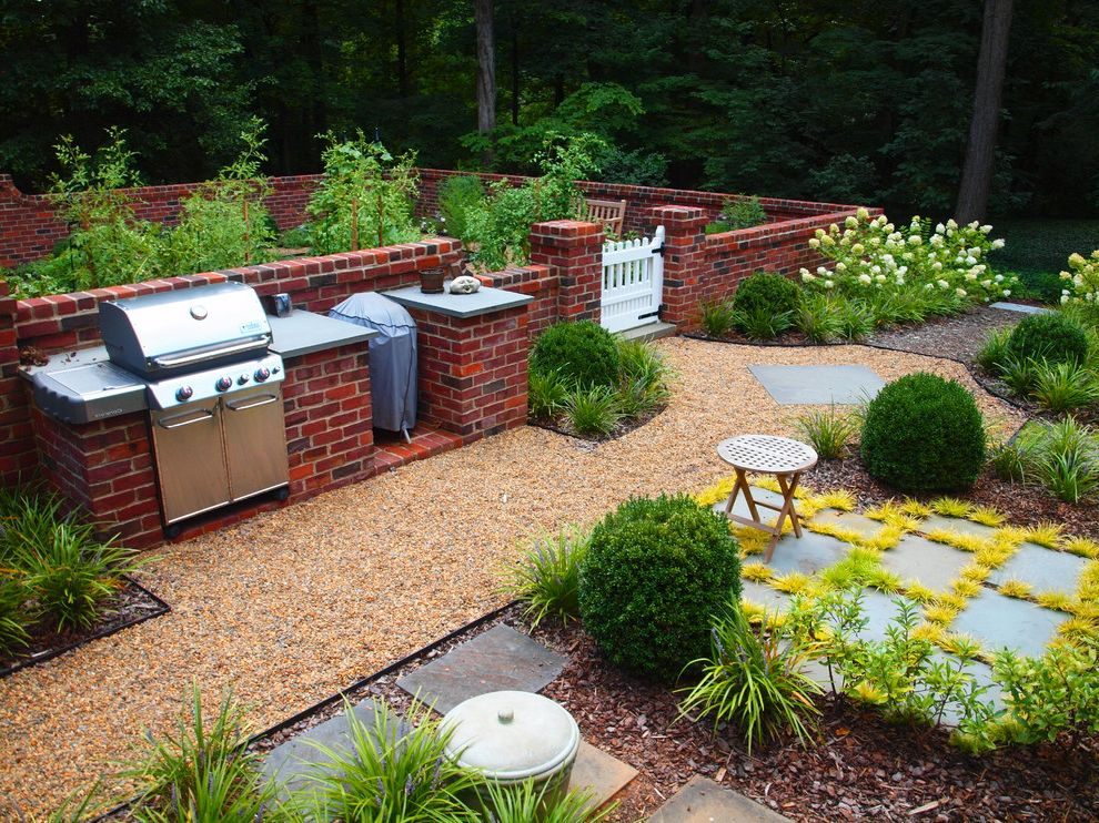 Electric Flat Top Grill with Traditional Landscape  and Bark Mulch Brick Wall Flowers Garden Walls Gate Gravel Path Ground Cover Kitchen Garden Outdoor Grill Outdoor Kitchen Pea Gravel Picket Fence Stool Wood Chips Woodsy
