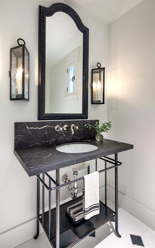 Electrical Distributing Inc with Farmhouse Powder Room  and Arched Mirror Black and White Floor Tile Black Countertop Wall Mounted Faucet Wall Sconce