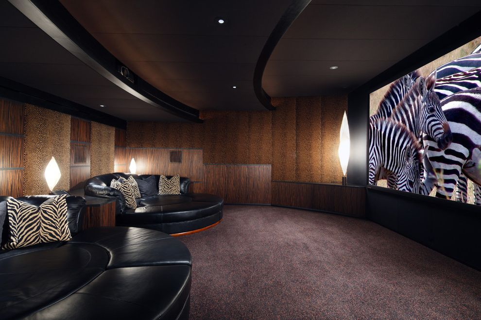 Elk River Theater   Southwestern Home Theater Also Animal Print Black Leather Brown Carpeting Pillows Recessed Lights Round Sofa Soffit Wood Paneling Zebra Print