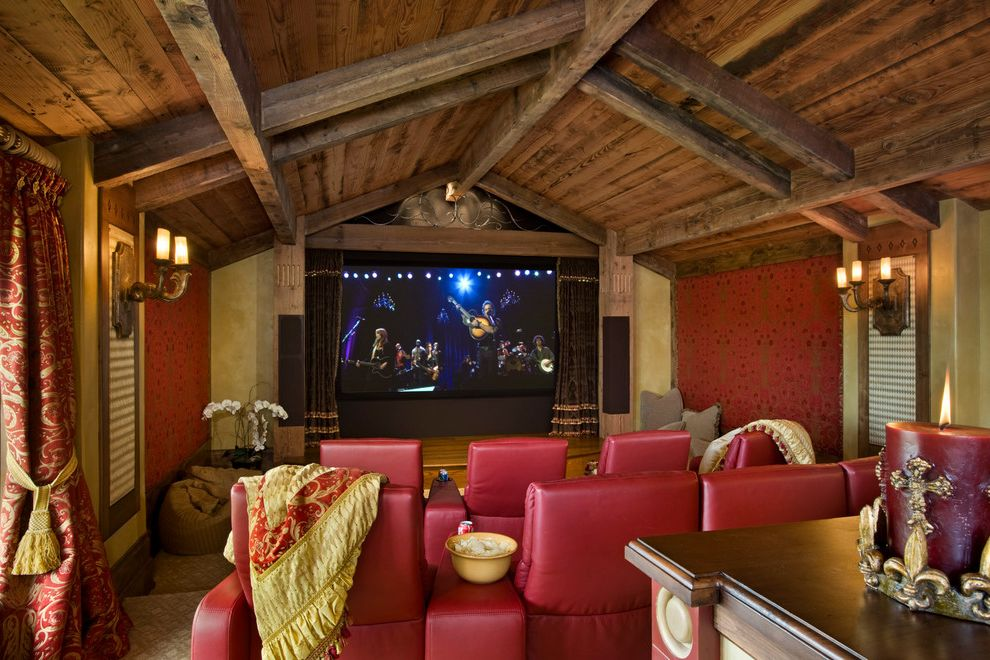 Elk River Theater with Rustic Home Theater Also Beams Carpet Drapes Home Theater Media Room Movie Room Red Leather Chairs Red Walls Rustic Wood Sconce Screening Room Sloped Ceiling Theater Seating Timber Accents Wall Treatment Wood Paneling