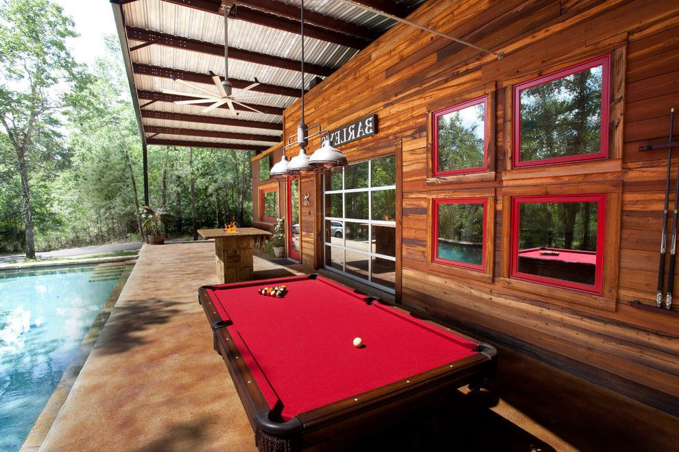 Elliptical Pool Table   Rustic Patio Also Bar Big Ass Fan Creosote Fire Pit Garage Door Metal Roof Outdoor Living Pool Pool Table Red Red Windows Rustic Stain Concrete Stained Concrete Steel Building