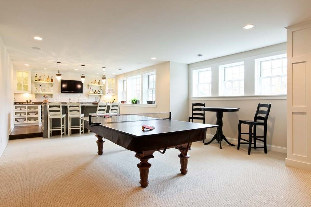 Elliptical Pool Table   Traditional Basement Also Bar Area Baseboards Cafe Table Ceiling Lighting Double Hung Windows Games Room Lower Level Ping Pong Table Rec Room Recessed Lighting Wet Bar