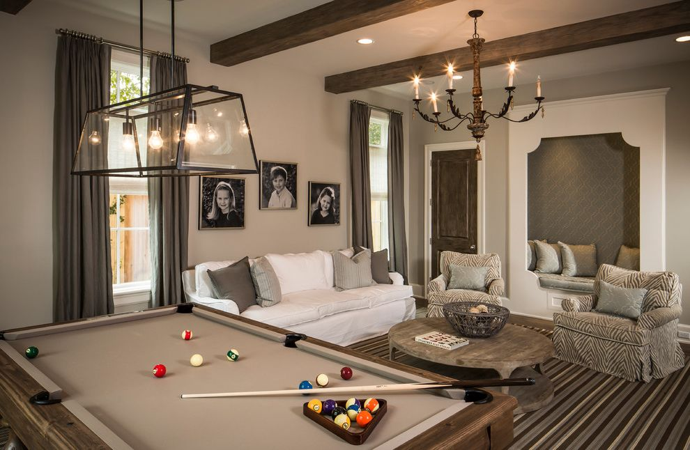 Elliptical Pool Table   Traditional Family Room  and Arm Chair Beige Walls Black and White Photography Chandelier Long Curtain Panels Niche Nook Pillows Pool Table Round Coffee Table Striped Area Rug Tall Windows Tone on Tone White Sofa