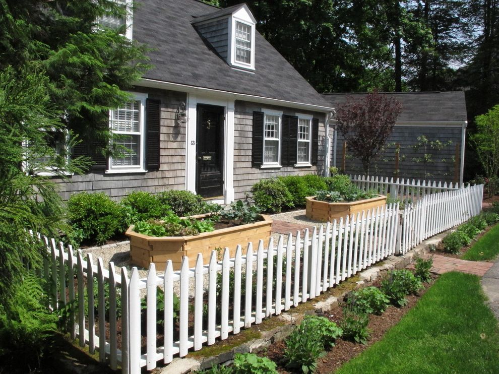 Ellis Home and Garden with Traditional Landscape  and Brick Path Cape Cod Style Curb Appeal Dormers Edible Garden Front Door Front Yard Gravel Picket Fence Raised Beds Shingle Siding Vegetable Garden Window Shutters Wood Fence