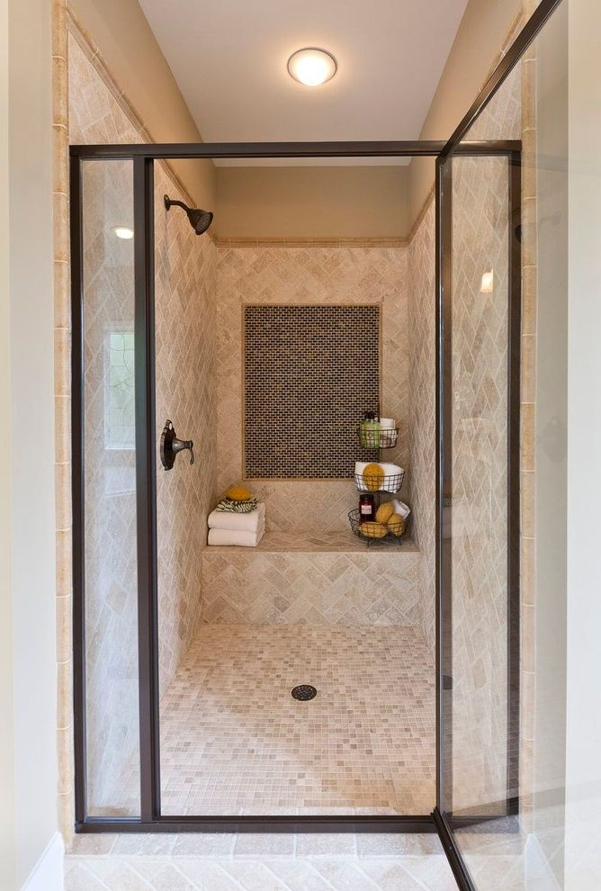 Emser Tile Scottsdale   Traditional Bathroom Also Ceiling Light Chevron Tile Pattern Dark Hardware Glass Door Khaki Painted Wall Neutral Colors Shower Caddy Shower Seat Small Tile Floor Steel Frame Step in Shower Tile Backsplash Tile Edging Tile Trim