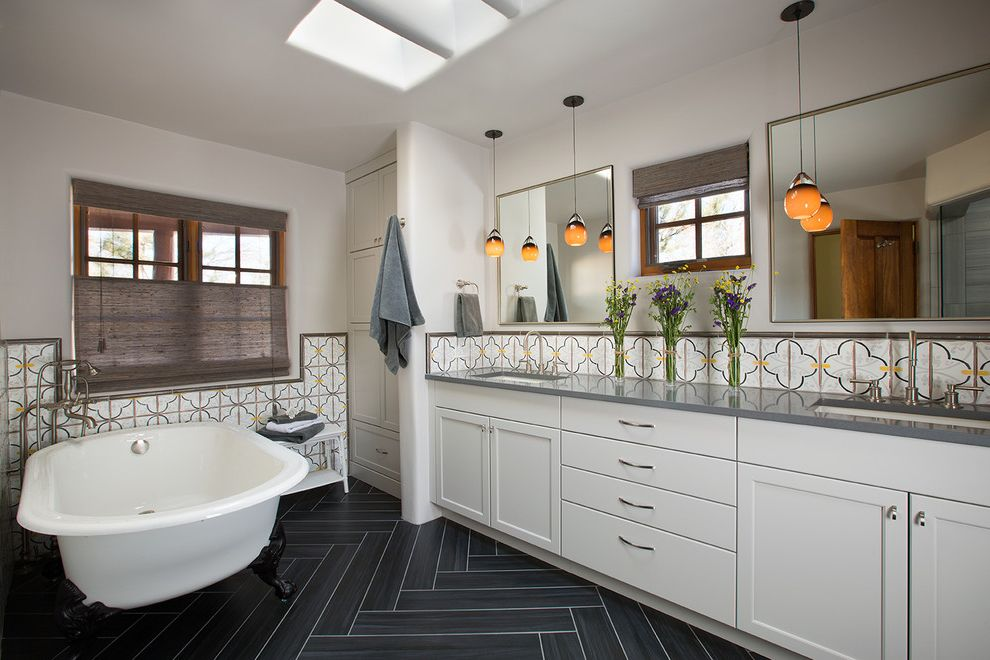 Emser Tile Scottsdale with Southwestern Bathroom  and Double Sinks Herringbone Tile Floor Painted Tile Pendant Lights Skylights Spa Bathroom Wall Mirrors Window Window Shade