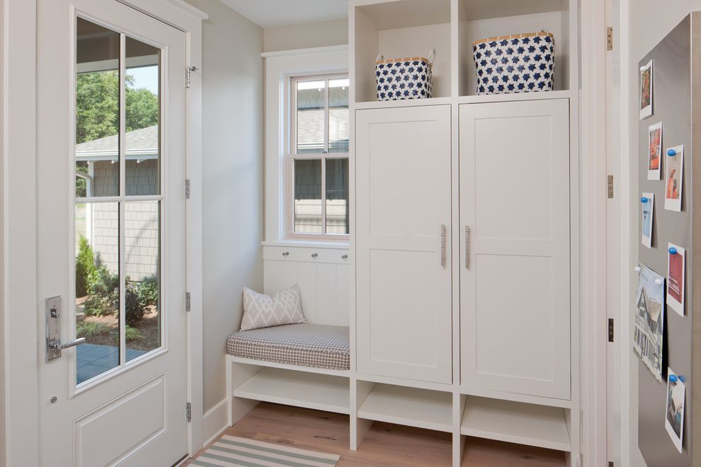 Emtek Keyless Entry with Beach Style Entry  and Beige Bench Beige Cabinets Beige Molding Beige Shelves Beige Trim Beige Wall Built in Bench Bulletin Board Entry Entryway Entryway Storage Glass Door Mudroom Wood Floor