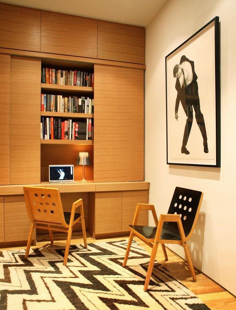 Enclosed Desk   Modern Home Office Also Artwork Bamboo Bookshelves Built in Bookshelves Chair Custom Designed Carpet by Axis Mundi Desk Oak Sliding Doors Robert Longo Roland Rainer Rug Storage Tibetan Carpet Wood