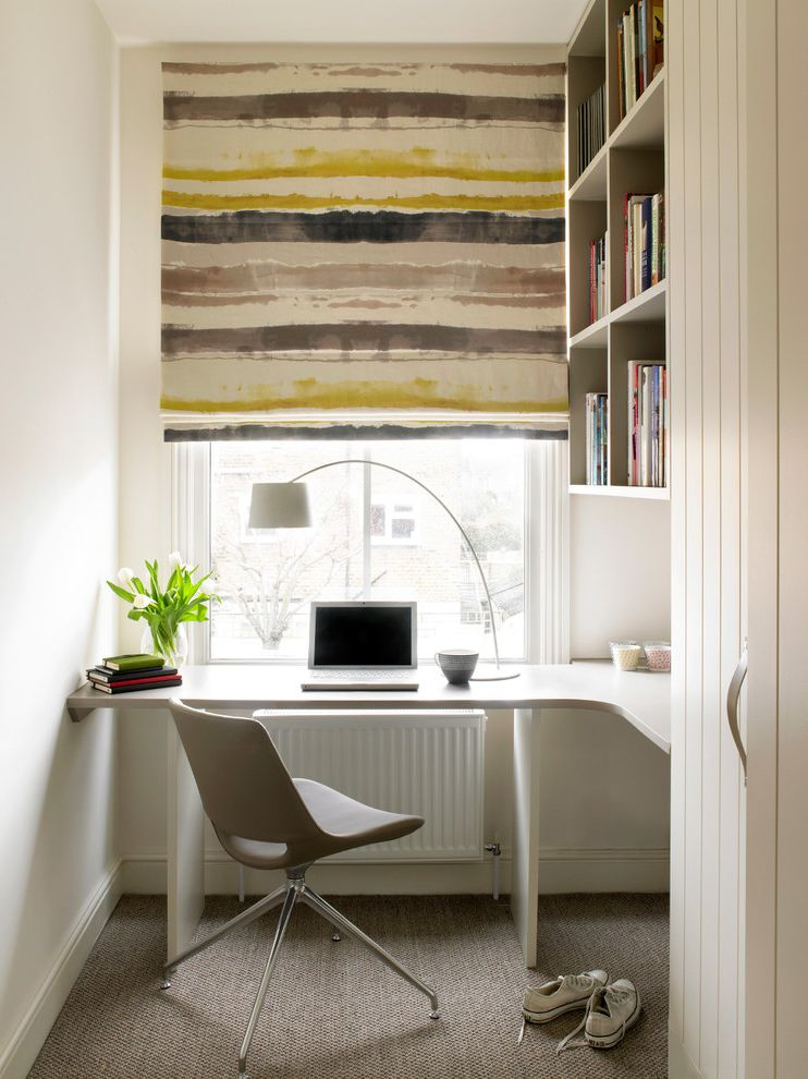 Enclosed Desk with Contemporary Home Office  and Beige Carpet Beige Desk Chair Beige Striped Shade Built in Bookcase Built in Shelves Corner Desk L Shaped Desk Office Nook Spare Room Student Room White Desk White Radiator White Wall