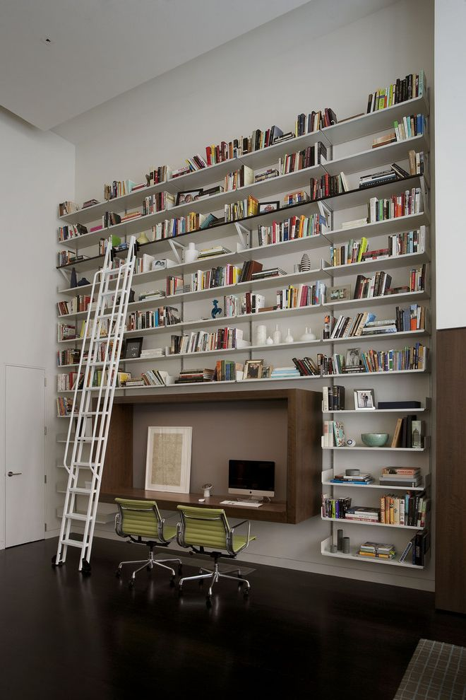 Enclosed Desk with Contemporary Home Office  and Black Floor Bookcase Bookcase with Ladder Box Shelf Brown Dark Floor Desk Desk Chair Green Chair High Ceiling Ladder Library Shelves Swivel Chair