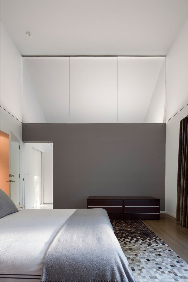 Energy Solutions Oakland   Contemporary Bedroom Also Clerestory Window Dark Wood Dresser Gray Bedding Gray Wall High Ceilings Interior Window Patchwork Rug