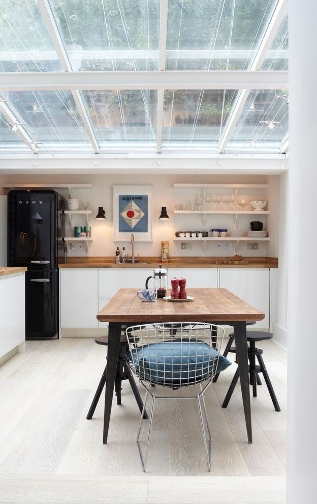 Energy Solutions Oakland with  Kitchen Also Bertoia Black Fridge Glass Ceiling Kitchen Shelves Kitchen Stools Kitchen Table Open Shelves Smeg Smeg Bridge White and Wood Wooden Worktops