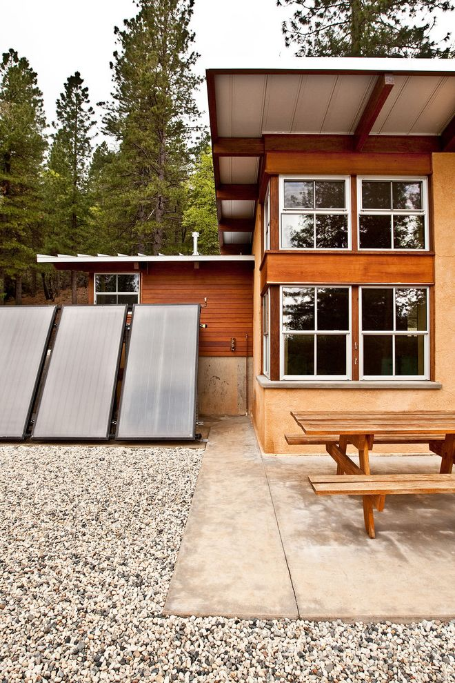 Energy Solutions Oakland with Rustic Exterior  and Concrete Terrace Earth Plaster Eric Millette Photography Metal Roof Off Grid Solar Hot Water Collectors Straw Bale Wood Siding