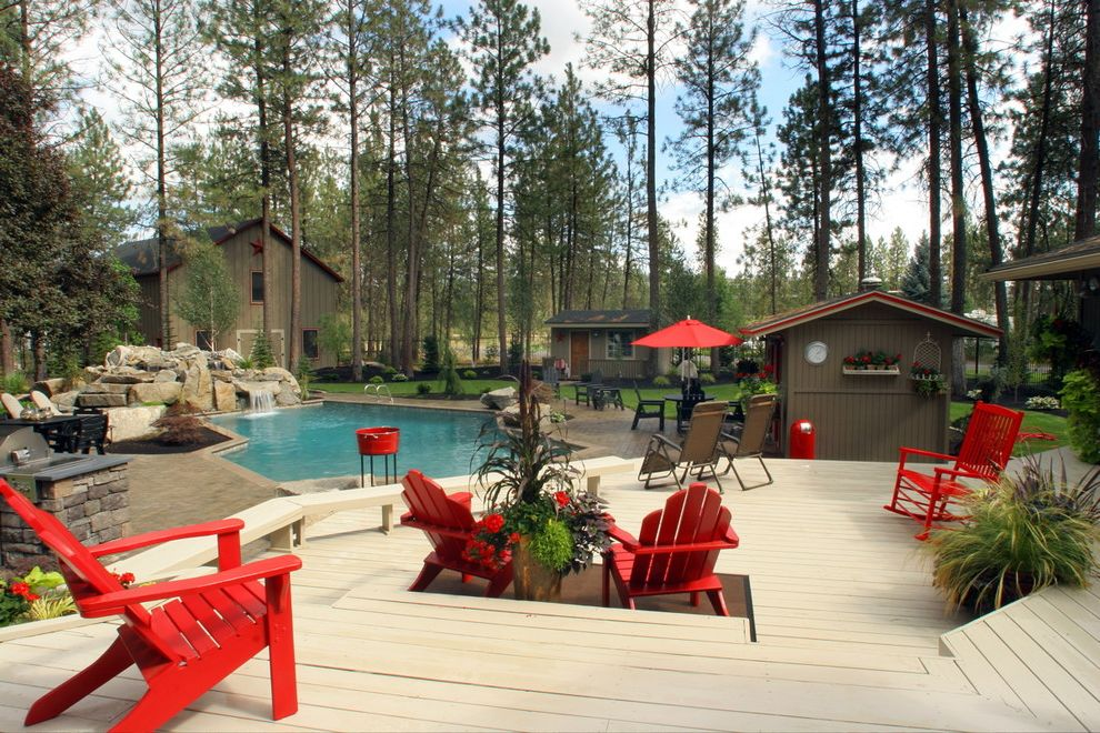 Ennis Furniture Spokane   Traditional Deck  and Backyard Barn Bench Boulder Brown Composite Decking Lawn Patio Pavers Pool Red Adirondack Furniture Red Trim Shed Steps Stone Tiered Water Feature Waterfall