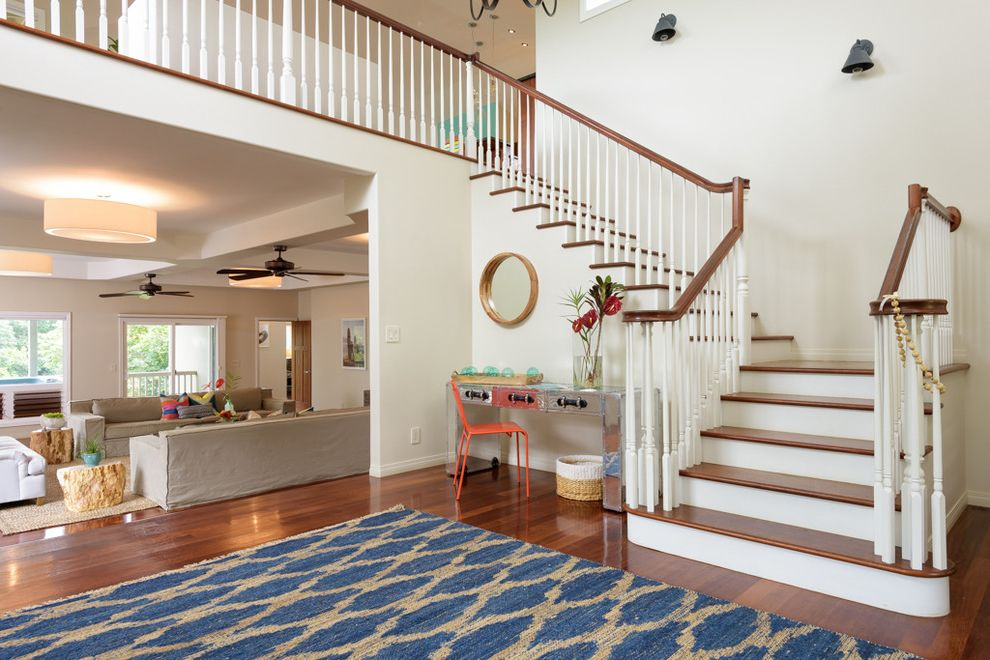 Equity Real Estate Utah with Beach Style Staircase  and Beach Home Coastal Decor Coastal Home Entry Hawaii Island Living Kauai Lue Area Rug Luxury Real Estate Luxury Vacation Mirrored Desk Orange Chair Princeville Round Mirror Vacation Home